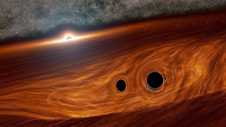 دو سیاهچاله با هم برخورد می کنند و شعله های آتش فوق العاده عجیب ایجاد می کند